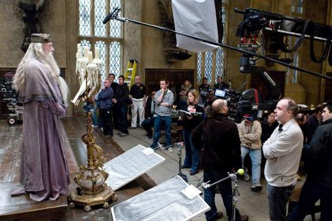 Director David Yates and crew watch Michael Gambon as Albus Dumbledore film a scene