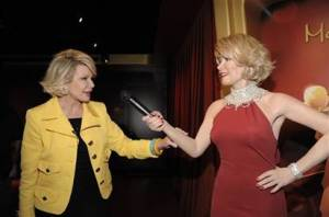 Comedienne Joan Rivers touches a wax figure of herself