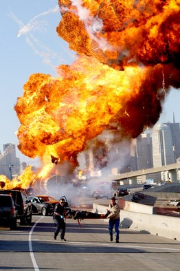 A victim is carried from the wreckage of an exploding oil tanker truck in the first episode of NBC's 'Trauma.'