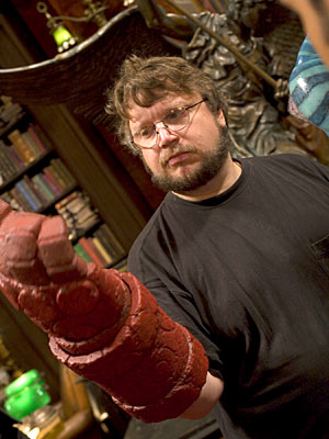 Guillermo del Toro with a Hell Boy hand